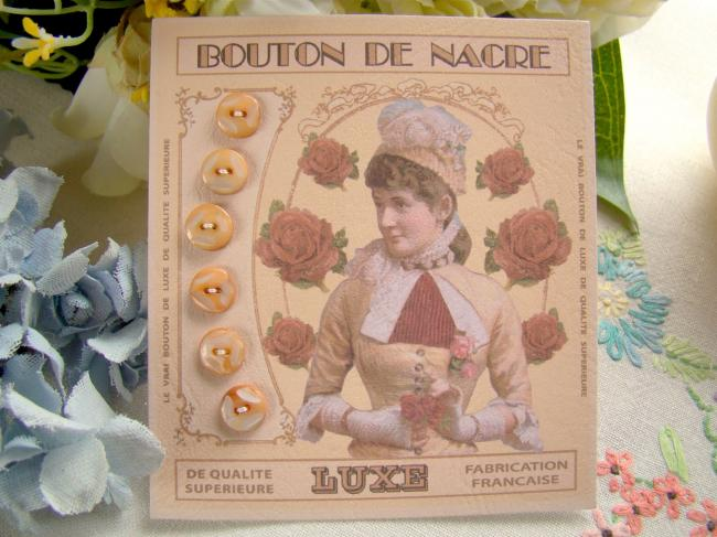 Lovely card with 6 antique engraved buttons in mother of pearl, apricot color