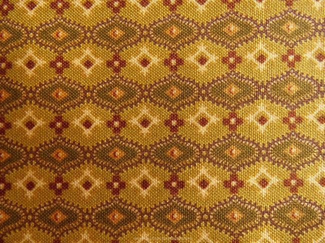 Coupon de coton à fond moutarde et motif géométrique bronze