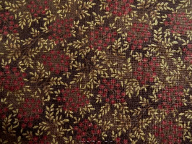 Coupon de coton à fond marron foncé avec motif de petites fleurs rouge rouille